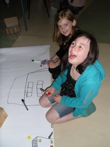 Neave and Elena draw their homes on the neverending scroll!
