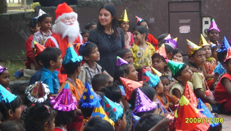 Santa and the children enjoy the magic show. Millennium Park, Kolkata